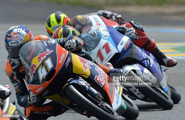 South Africa rider Brad Binder competes on his Red Bull KTM Ajo N��41 ahead Belgian's rider Livio Loi on his Honda RW Racing GP BV N��11 and clocked...