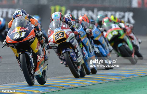 South Africa rider Brad Binder competes on his Red Bull KTM Ajo N��41 as he leads ahead of Italy's rider Niccolo Antonelli on his Honda...
