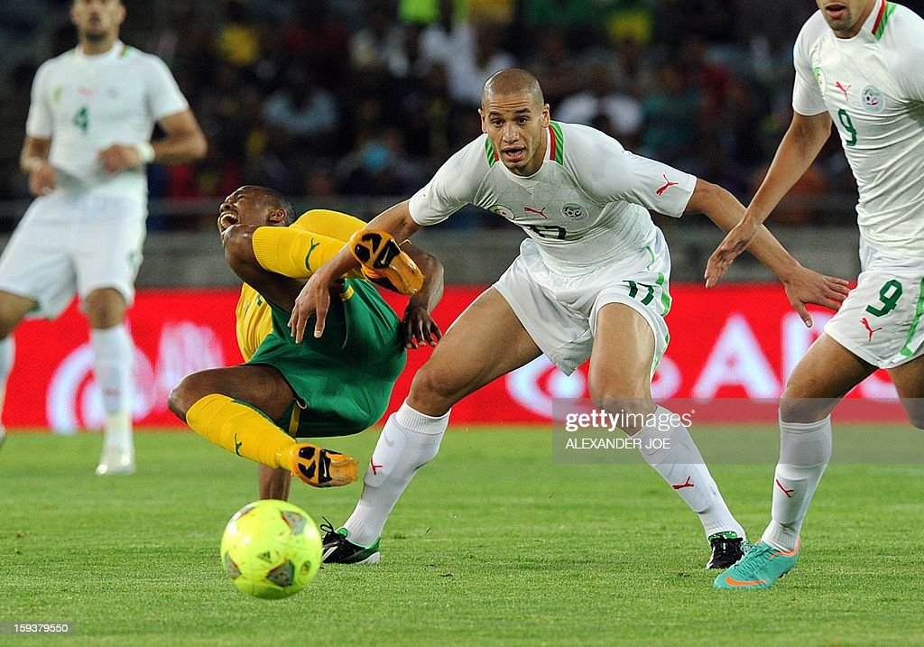 South Africa 's Kagisho Dikgacoi (L) is tackled by Algeria's Adlane Guedioura during a friendly football match between South Africa's Bafana Bafana and Algeria in Soweto on January 12 , 2013, ahead of the 2013 African Cup of Nations that will take place in South Africa from January 19 to February 10.
