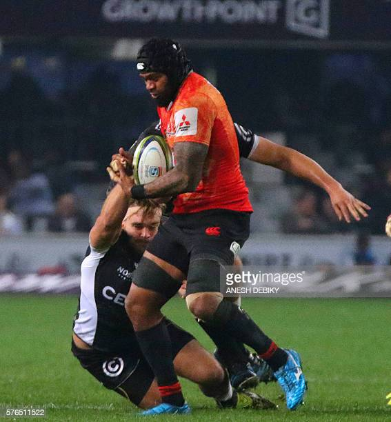 South Africa Shark's Dale Chadwick and Ettienne Oosthuizen tackle Japan Sunwolves' Faatiga Lemalu during the Super 18 Rugby match South Africa's...