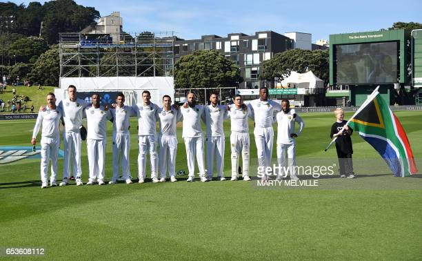 South Africa stand for the national anthems during the 2nd International cricket test match between New Zealand and South Africa at the Basin Reserve...