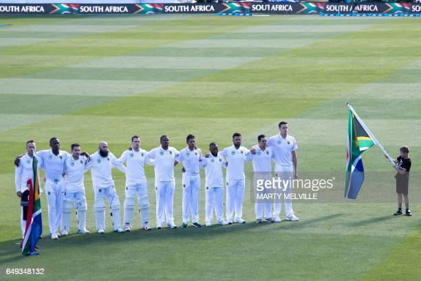 CORRECTION South Africa stand for their national anthem during day one of the 1st International cricket test match between New Zealand and South...