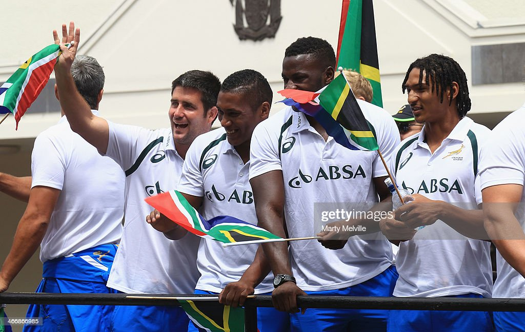 South Africa team members wave to the fans during a South African street parade ahead of the 2014 Wellington Sevens on February 5, 2014 in Wellington, New Zealand.