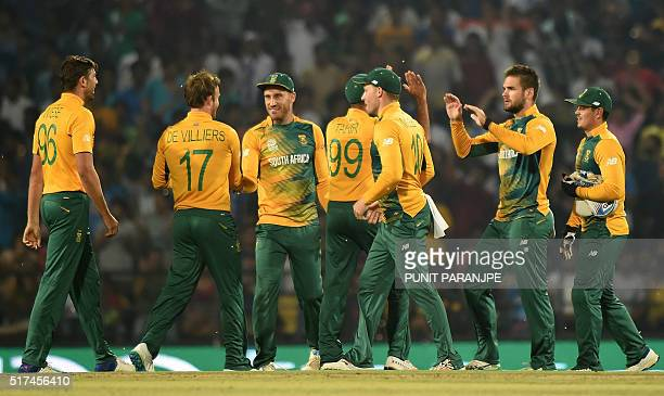 South Africa team players led by captain Faf du Plessis celebrate after the wicket of West Indies batsman Andre Fletcher during the World T20 cricket...