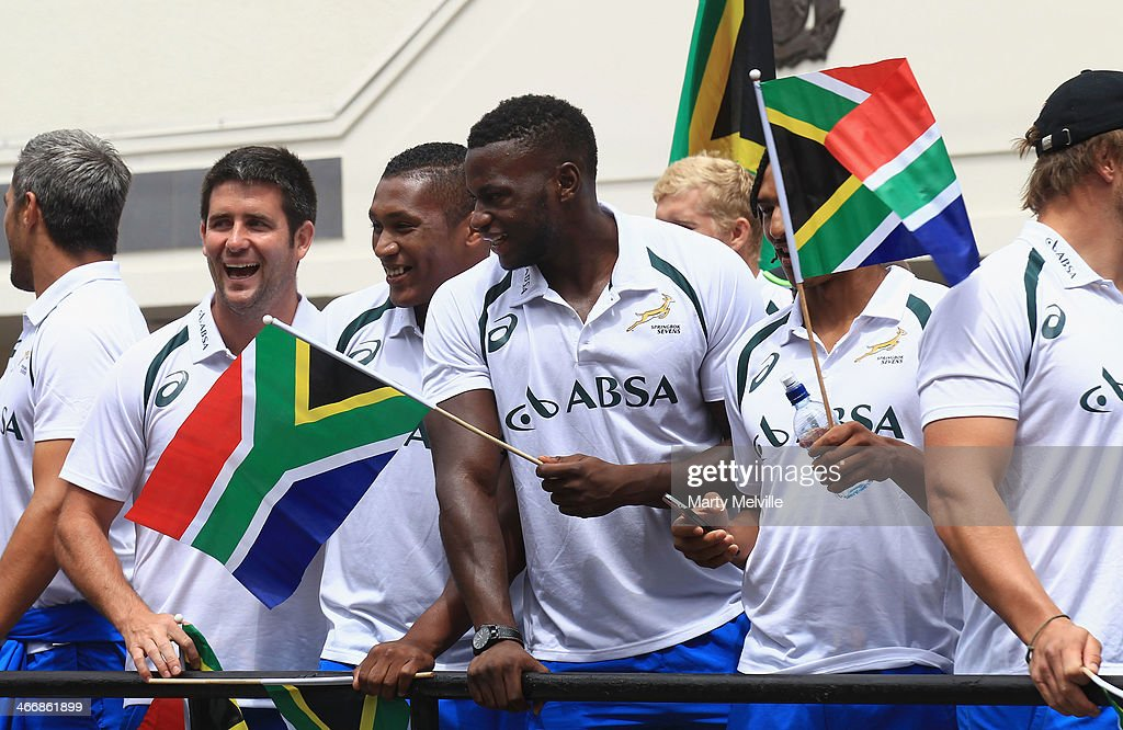 South Africa wave players wave to fans during a South African street parade ahead of the 2014 Wellington Sevens on February 5, 2014 in Wellington, New Zealand.