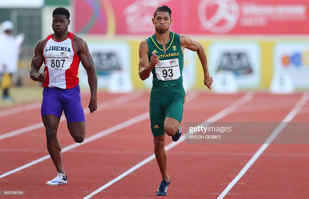 South Africa Wayde van Niekerk (R) runs ahead of Liberia Emmanuel Matadi (L) to the 200m for men final during day 5 of the Confederation of African Athletics (CAA) Championships held in Durban, on June 26, 2016. / AFP / Anesh Debiky