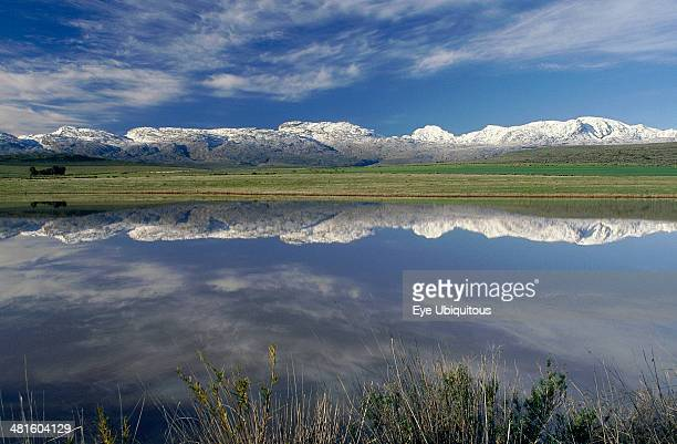 South Africa Western Cape Ceres Landscape with snow covered mountains reflected in dam