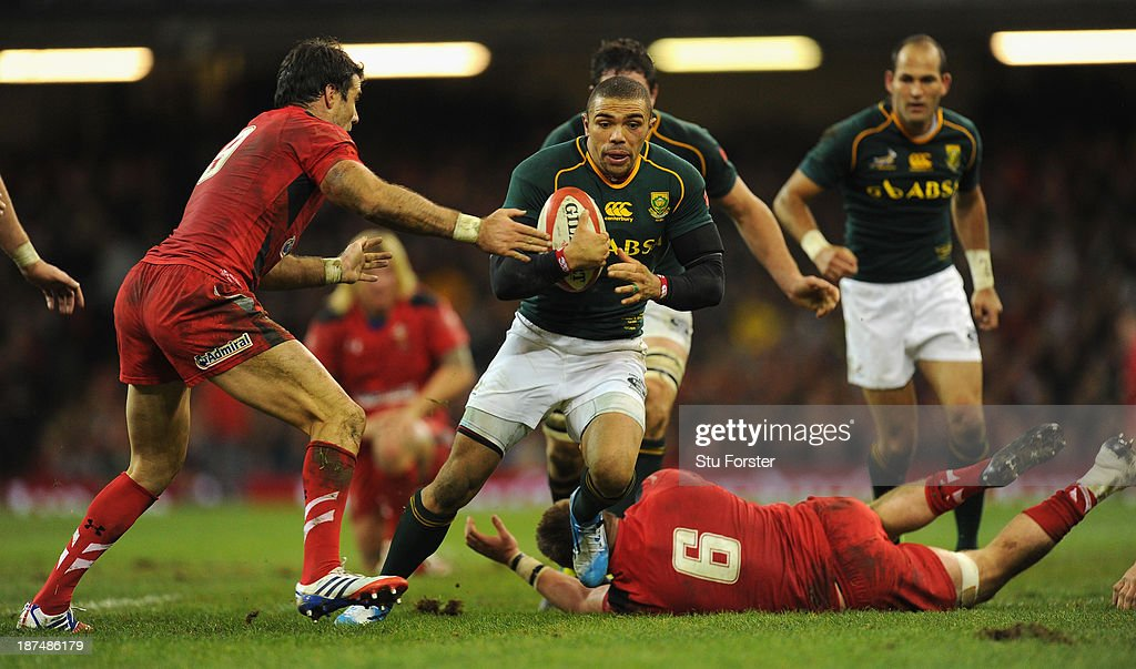 South Africa wing <a gi-track='captionPersonalityLinkClicked' href=/galleries/search?phrase=Bryan+Habana&family=editorial&specificpeople=221391 ng-click='$event.stopPropagation()'>Bryan Habana</a> makes a break during the International Match between Wales and South Africa at the Millennium Stadium on November 9, 2013 in Cardiff, Wales.