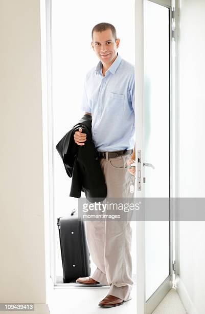 South Africa, Young businessman entering home