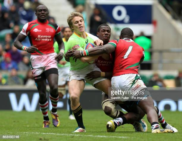 South Africa'a Mark Richards is challenged by Kenya's Horace Otieno in the Plate Final during day two of the Marriott London Sevens at Twickenham...