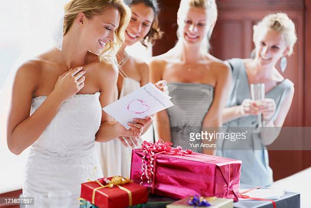 South Africa,Cape Town, Bride and bridesmaids unpacking gifts