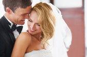 South Africa,Cape Town, Newly wed couple embracing