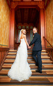 South Africa,Cape Town, Young couple standing on steps in hallway