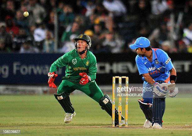 South African AB de Villiers tries to catch out India's Virat Kohli during the 4th One Day International between India and South Africa St George's...