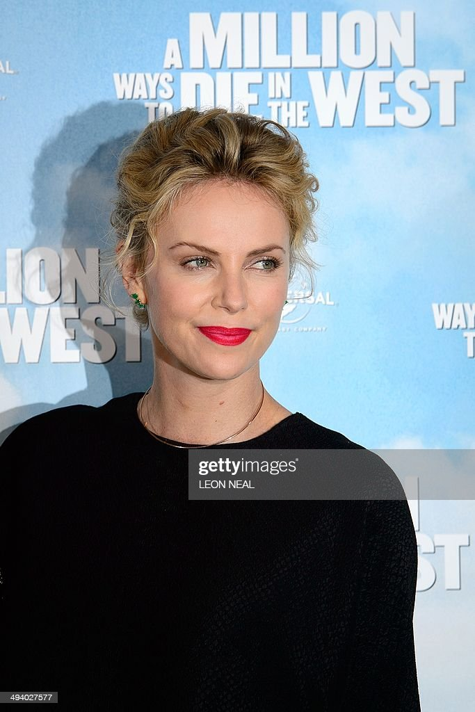 South African actress Charlize Theron pose for photographers during a photo call for her latest film 'A Million Ways To Die In The West' at Claridges, central London, on May 27, 2014. Starring Seth MacFarlane, Liam Neeson, Amanda Seyfried and Charlize Theron, the film is about a man in America's Wild West who has struggles to regain his courage after backing out of a gunfight.