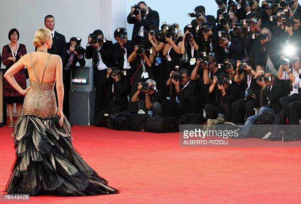 South African actress Charlize Theron poses as she arrives for the screening of her movie 'In the valley of Elah' during the 64th Venice...