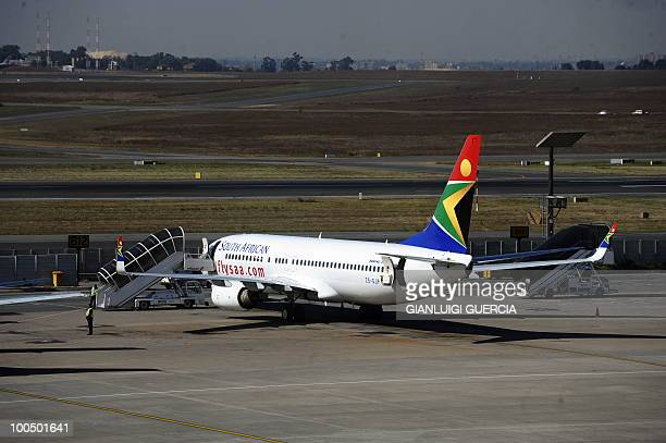 A South African airways carrier is parked in a bay on the tarmac on May 25 2010 at the Johannesburg OR Tambo International airport in Johannesburg...