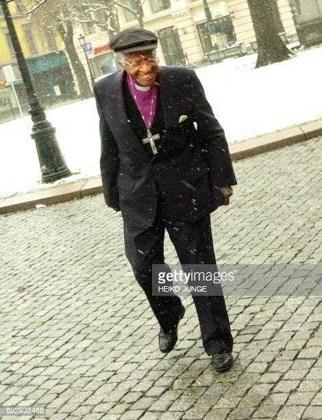 South African Anglican Archbishop Desmond Tutu enjoys a walk in the snow as he visits Oslo 02 April 2000 Tutu visits Norway from 01 April to 04 April...