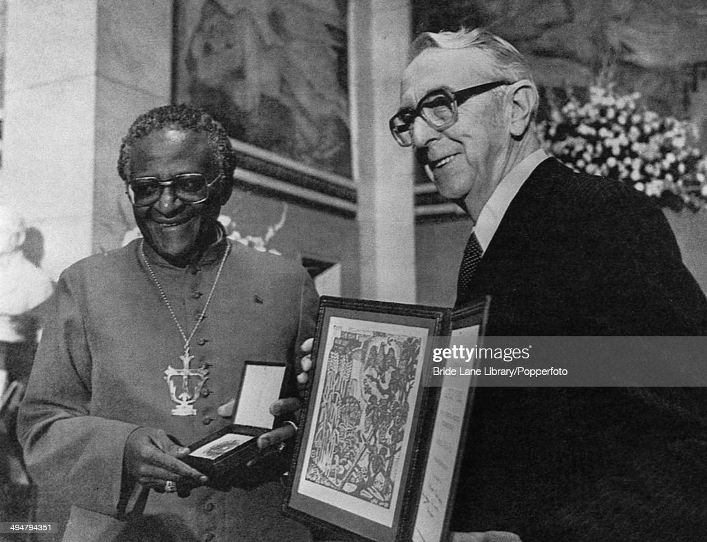 South African Anglican Archbishop <a gi-track='captionPersonalityLinkClicked' href=/galleries/search?phrase=Desmond+Tutu&family=editorial&specificpeople=214730 ng-click='$event.stopPropagation()'>Desmond Tutu</a> (left) receives the Nobel Peace Prize for his campaigning work against the apartheid regime in South Africa, 12th October 1984. The prize was awarded by the chairman of the Norwegian Nobel Committee Egil Aarvik (1912 - 1990, right) in the auditorium at Oslo University, Oslo, Norway.