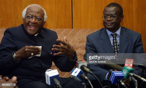 South African Anglican Archbishop Desmond Tutu speaks to the press 14 August 2003 as Minister for Justice Kiraitu Murungi watches after he arrived in...