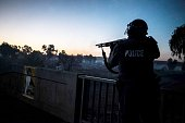South African anti riot policemen advance on a bridge on July 21 2016 as protesters block a highway in Meyrton during a service delivery protest...