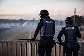 South African anti riot policemen observe from a bridge on July 21 2016 as protesters bloc a highway in Meyrton during a service delivery protest...