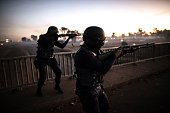 South African anti riot policemen open fire on July 21 2016 on protesters blocking the road on a highway in Meyerton during a service delivery...