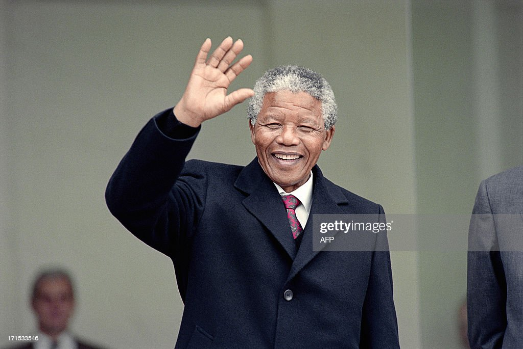 South African anti-apartheid leader and African National Congress (ANC) member <a gi-track='captionPersonalityLinkClicked' href=/galleries/search?phrase=Nelson+Mandela&family=editorial&specificpeople=118613 ng-click='$event.stopPropagation()'>Nelson Mandela</a> waves to the press as he arrives at the Elysee Palace, 07 June 1990, in Paris, to have talks with French president Francois Mitterrand. <a gi-track='captionPersonalityLinkClicked' href=/galleries/search?phrase=Nelson+Mandela&family=editorial&specificpeople=118613 ng-click='$event.stopPropagation()'>Nelson Mandela</a>, who was released from jail on 11 February 1990, is in Paris for a two-day official visit.