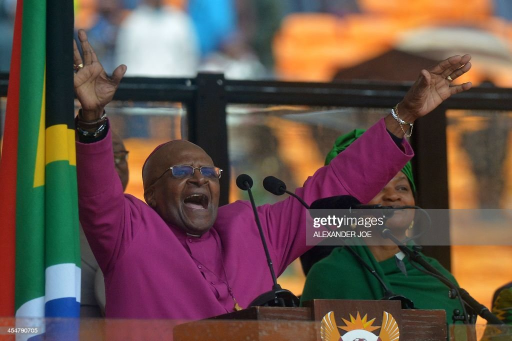South African Archbishop and Honorary Elders Desmond Tutu speaks during the memorial service of South African former president Nelson Mandela at the FNB Stadium (Soccer City) in Johannesburg on December 10, 2013. Mandela, the revered icon of the anti-apartheid struggle in South Africa and one of the towering political figures of the 20th century, died in Johannesburg on December 5 at age 95.