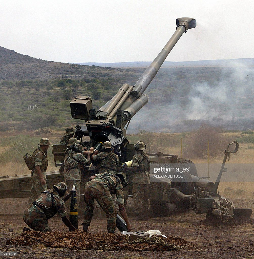 South African army gunners reload a 90mm howitzer during the annual force exercise dubbed Exercise Seboka in Lohatha in the Northern Cape 09 October...