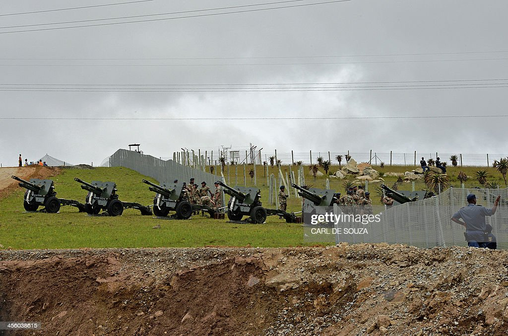 South African army military cannons are positioned outside South African former president Nelson Mandela's former home in Qunu during a practice run ceremony on December 13, 2013. South African troops lined the road to Nelson Mandela's burial site in his boyhood home at Qunu, as preparations for his funeral on December 15 got under way today. Mandela, the revered icon of the anti-apartheid struggle in South Africa and one of the towering political figures of the 20th century, died in Johannesburg on December 5 at age 95. AFP PHOTO / Carl de Souza