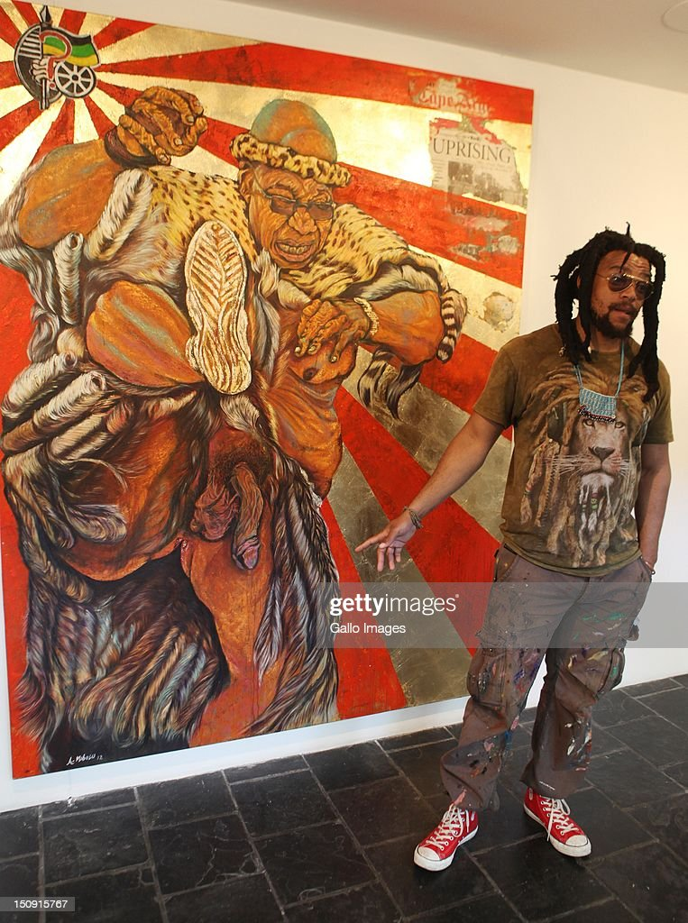 Image contains nudity) South African Artist Ayanda Mabulu with his painting of President Jacob Zuma on display at the AVA Gallery on 28 August 2012 in Cape Town, South Africa. Mabulu's painting of Zuma in traditional Zulu attire with his penis exposed, entitled 'Umshini Wam' (weapon of mass destruction), is part of the exhibition 'Our Fathers'.