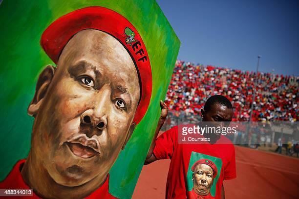 South African artist Michael Mkhize carries a portrait of South African presidential candidate Julius Malema during an Economic Freedom Fighters...