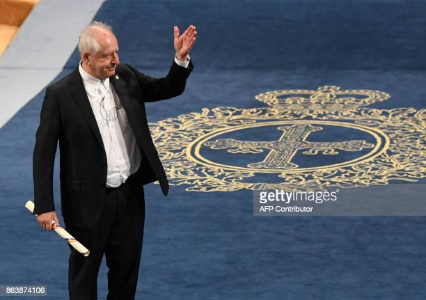 South African artist William Kentridge celebrates on stage after receiving the 2017 Princess of Asturias Award for Arts during the Princess of...