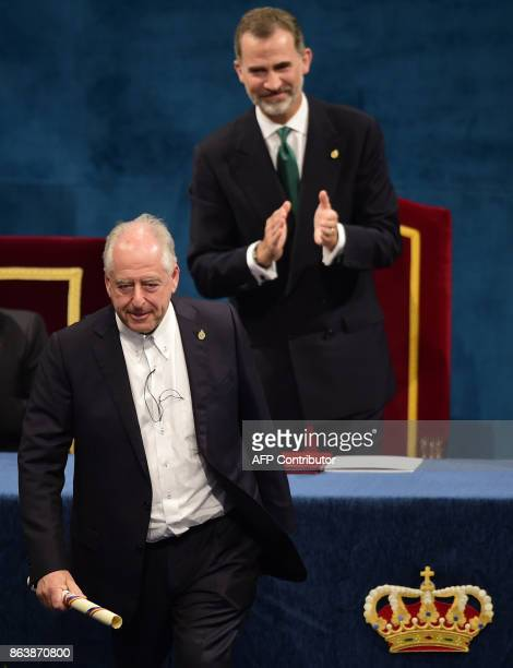 South African artist William Kentridge walks on stage after receiving the 2017 Princess of Asturias Award for Arts from Spain's King Felipe during...