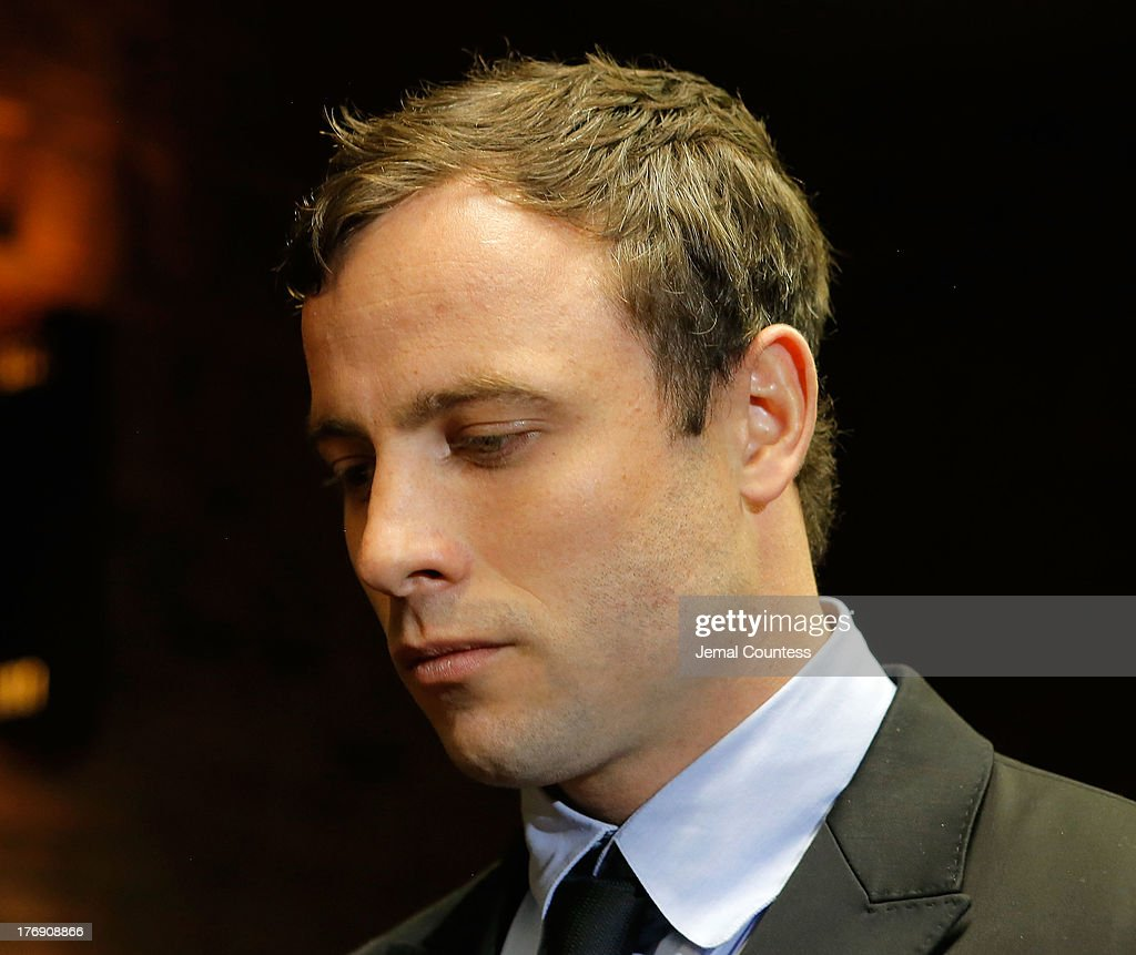 South African athlete Oscar Pistorius appears in Pretoria Magistrates Court for an indictment hearing on August 19 2013 in Pretoria South Africa...
