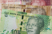 South African banknotes sit in this arranged photograph in Pretoria South Africa on Monday Dec 14 2015 South Africa's government was left trying to...