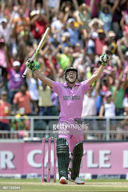 South African batsman AB de Villiers celebrates scoring a century during the second One Day International cricket match between South Africa and the...