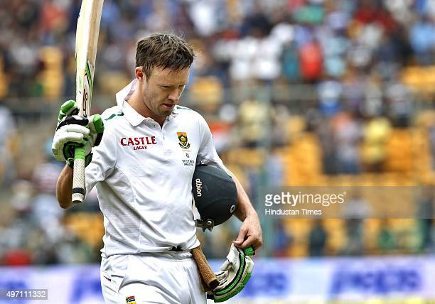 South African batsman AB de Villiers leaves the ground after dismissal by Indian player Ravindra Jadeja during the 2nd Test match between India and...