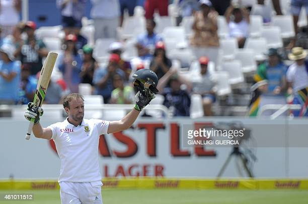South African batsman AB de Villiers raises his bat and helmet after scoring a century during the 3rd day of the third test match between South...