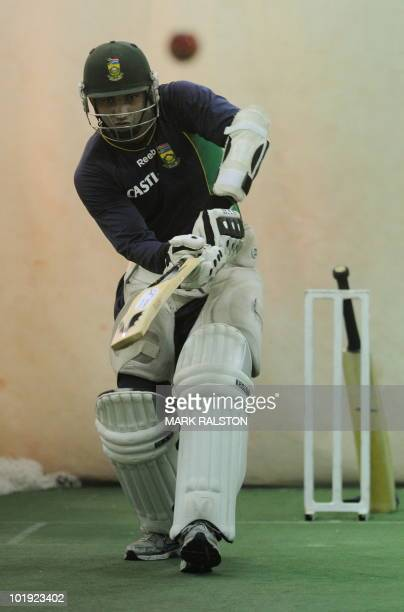 South African batsman Alviro Petersen watches the ball in the indoor nets during a rain affected practice session on the eve of the first Test...