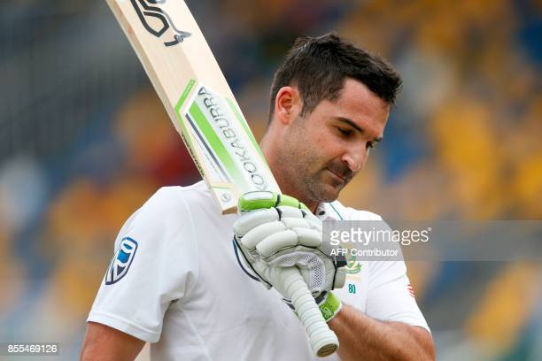 South African batsman Dean Elgar acknowledges the applause of the crowd walks back to the pavilion after his dismissal on 199 runs during the second...