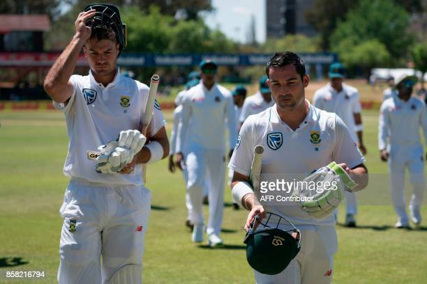 South African batsman Dean Elgar and South African batsman Aidan Markram leave the oval as the teams have a break for lunch during the first day of...