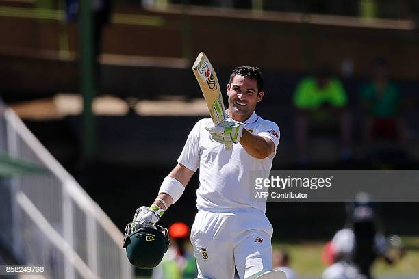South African batsman Dean Elgar celebrates a century during the first day of the second Test Match between South Africa and Bangladesh in...