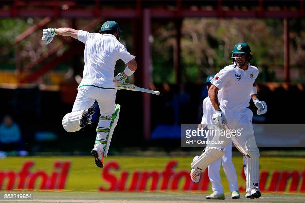 South African batsman Dean Elgar celebrates a century while leaping in the air during the first day of the second Test Match between South Africa and...