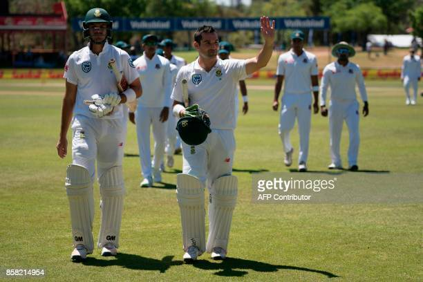 South African batsman Dean Elgar greets supporters as he leaves the oval with South African batsman Aidan Markram as the teams have a break for lunch...