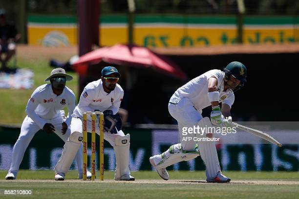 South African batsman Dean Elgar hits a ball during the first day of the second cricket Test Match between South Africa and Bangladesh in...