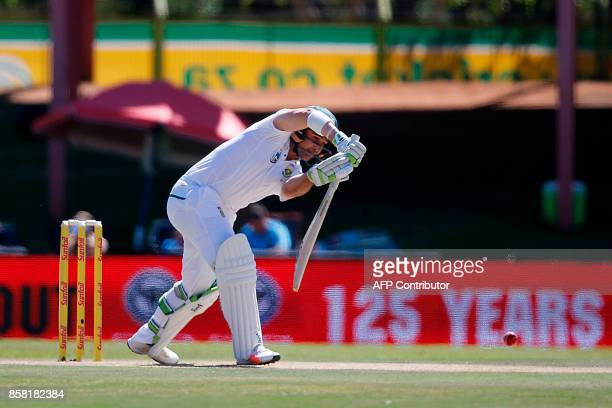 South African batsman Dean Elgar hits a four during the first day of the second Test Match between South Africa and Bangladesh in Bloemfontein on...