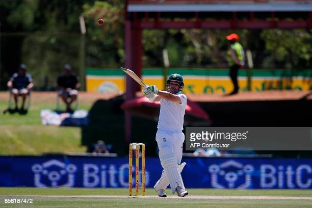 South African batsman Dean Elgar hits the ball during the first day of the second Test Match between South Africa and Bangladesh in Bloemfontein on...