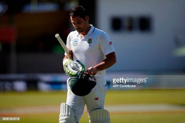 South African batsman Dean Elgar leaves the field after being caught out during the first day of the second cricket Test Match between South Africa...